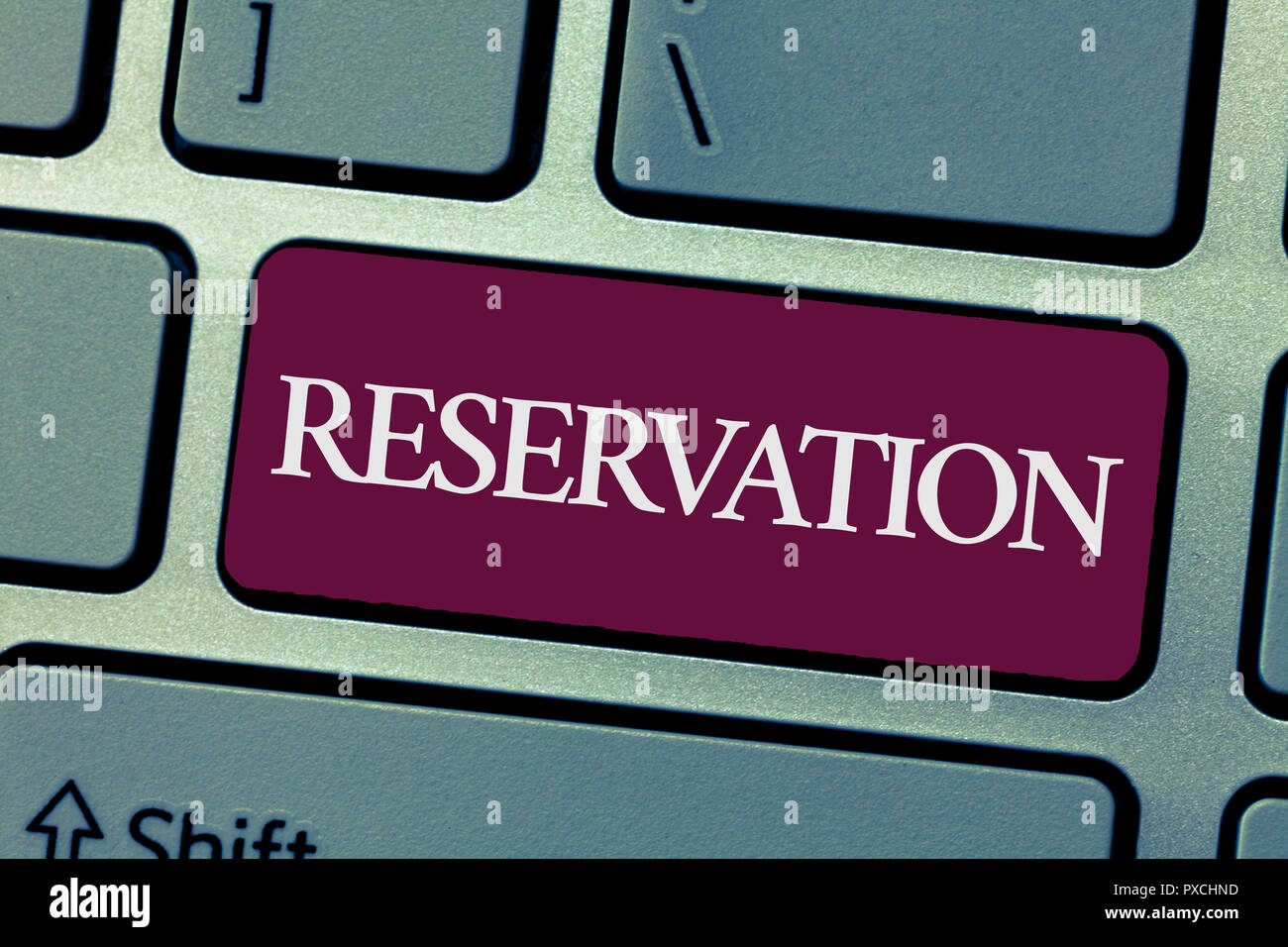 Handwriting text writing Reservation. Concept meaning Arrangement made so a seat somewhere is kept for someone. - Stock Image
