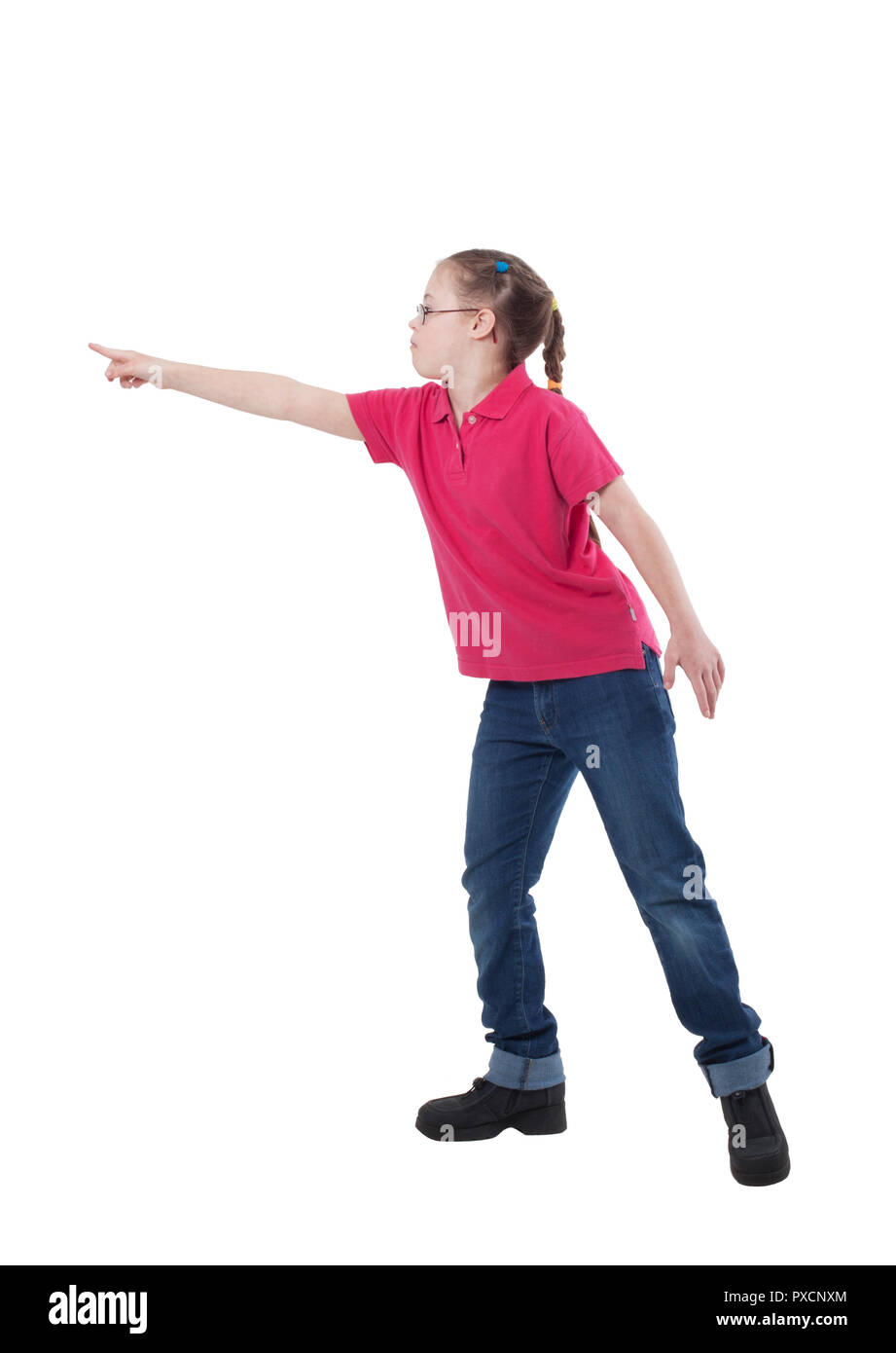 A girl with special needs in profile in full growth indicates something on a white background - Stock Image