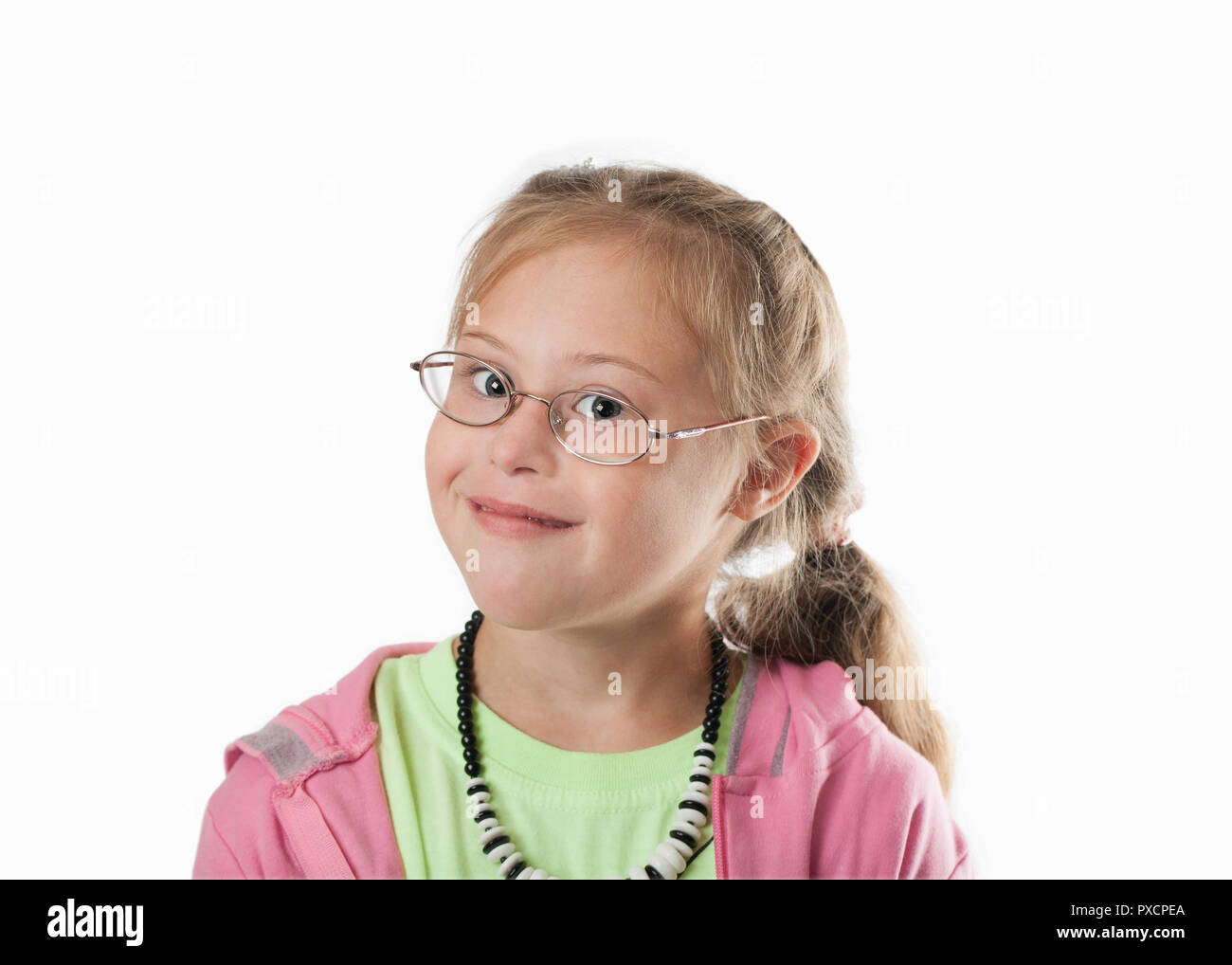 Portrait of a girl with special needs on a white background - Stock Image