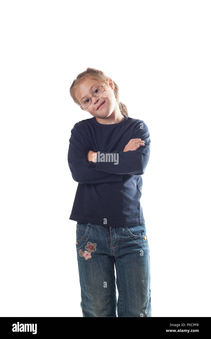 Standing with his hands crossed on his chest girl wearing jeans on a white background - Stock Image