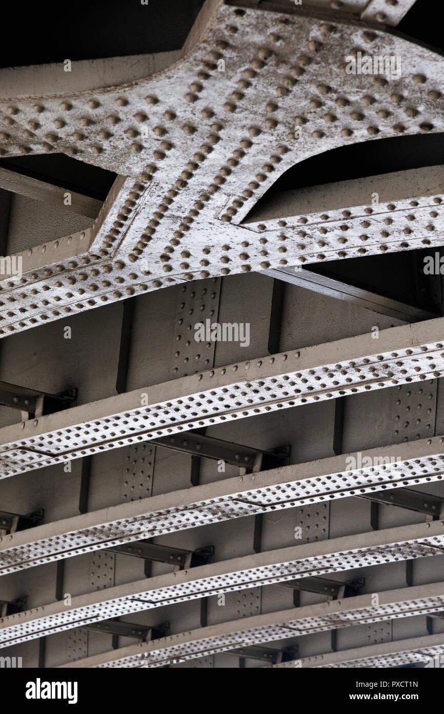Exposed structural steelwork beneath a bridge, London, UK. - Stock Image
