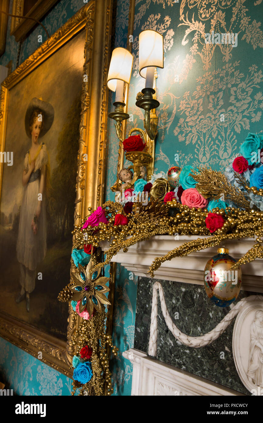 UK, England, Yorkshire, Castle Howard at Christmas, Turquoise Drawing Room, colour-themed decorations on mantel beside 1826 painting of Lady Mary Howa Stock Photo