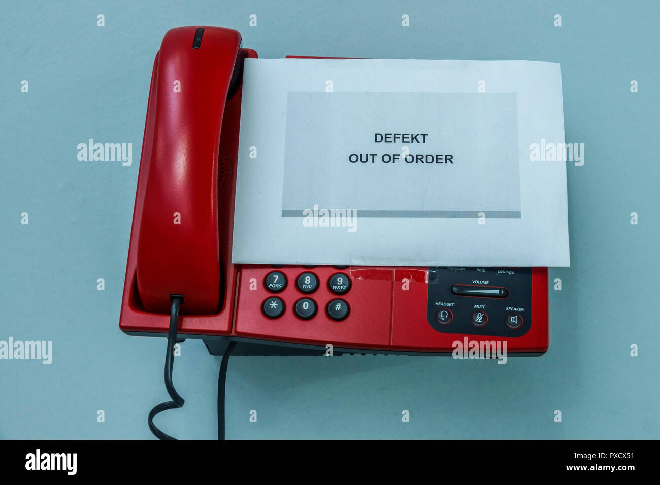Telephone with keypad out of order, defect - Stock Image