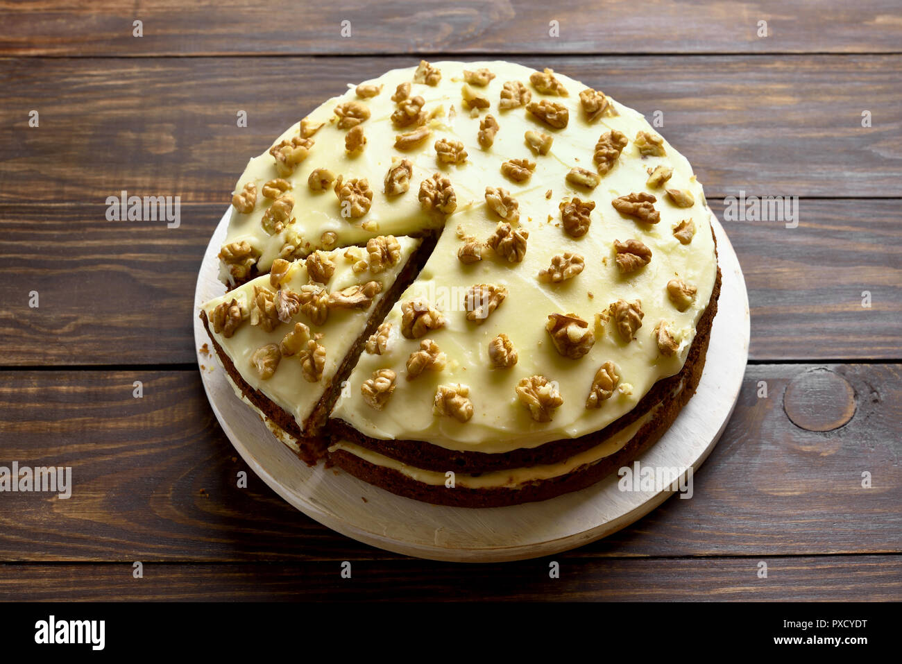 Tasty carrot cake on wooden table. Healthy homemade baking. - Stock Image
