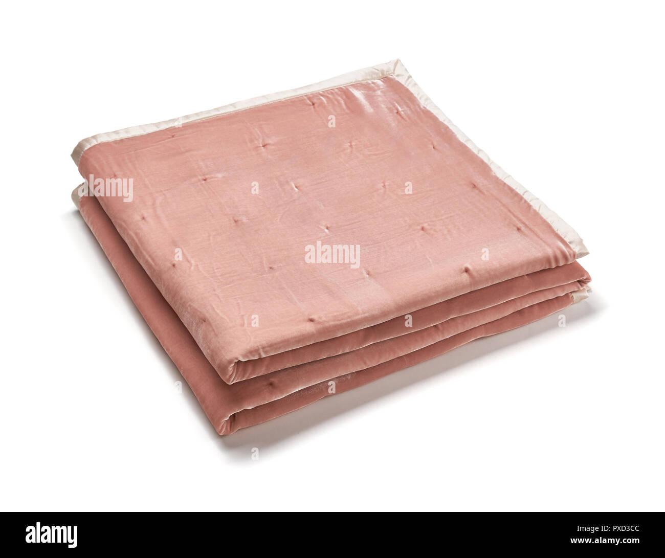 Pink blanket made of velor fabric, neatly folded, isolated on white background Stock Photo