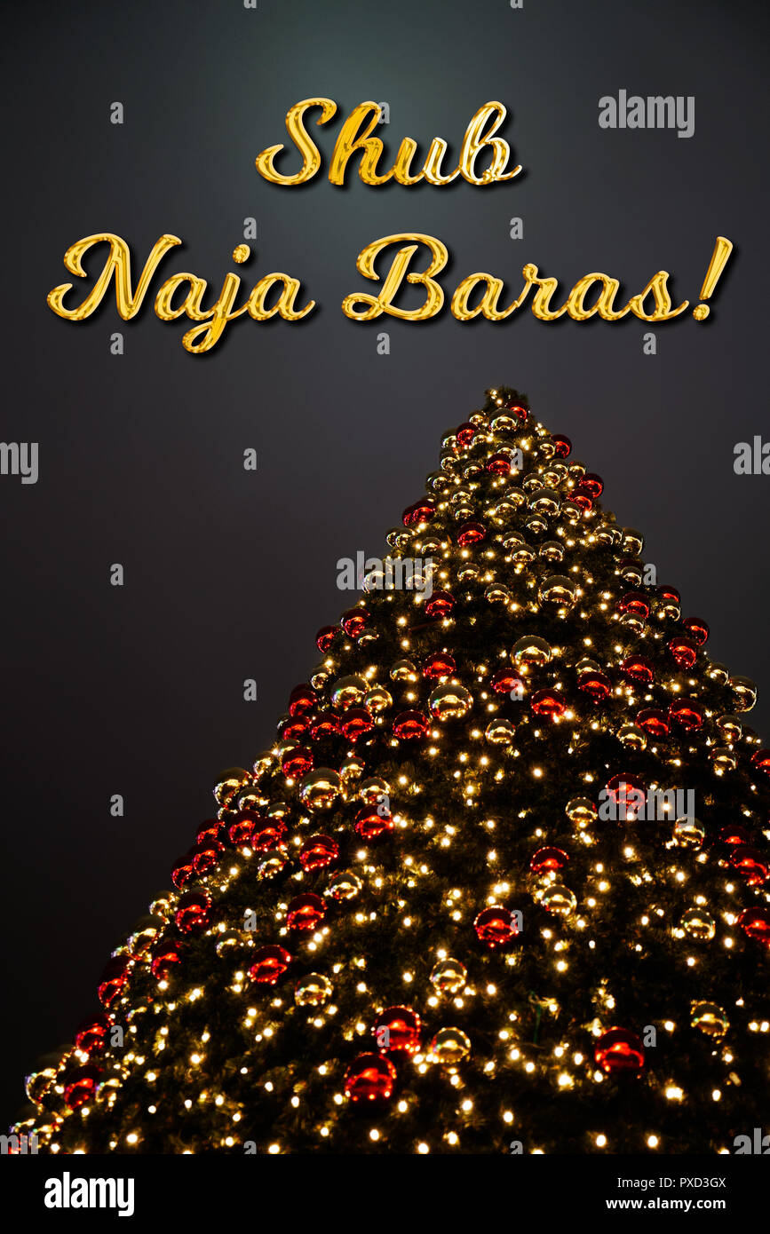 A Christmas Tree With Golden And Red Decoration The Hindi Text
