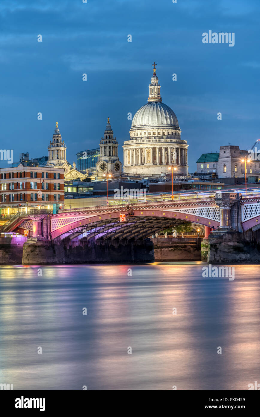 St Pauls Cathedral an Blackfriars Bridge in London at dusk - Stock Image