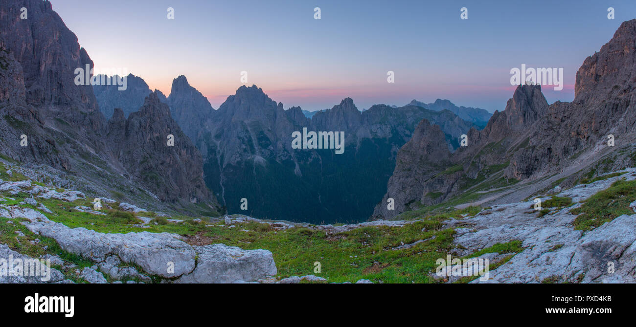 Wonderful sunrise in the Italian Alps, alpine scenary with craggy peaks, a vivid alpenglow and the serene atmosphere backcountry solitude can give. - Stock Image