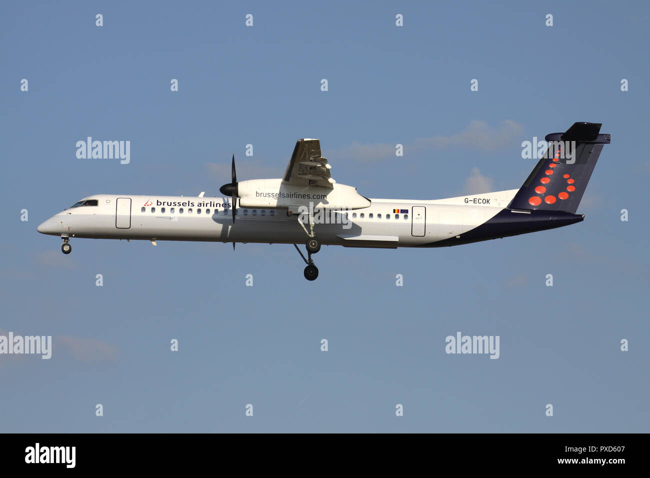 British flybe Bombardier Dash 8 Q400 in Brussels Airlines livery with registration G-ECOK on short final for runway 01 of Brussels Airport. - Stock Image