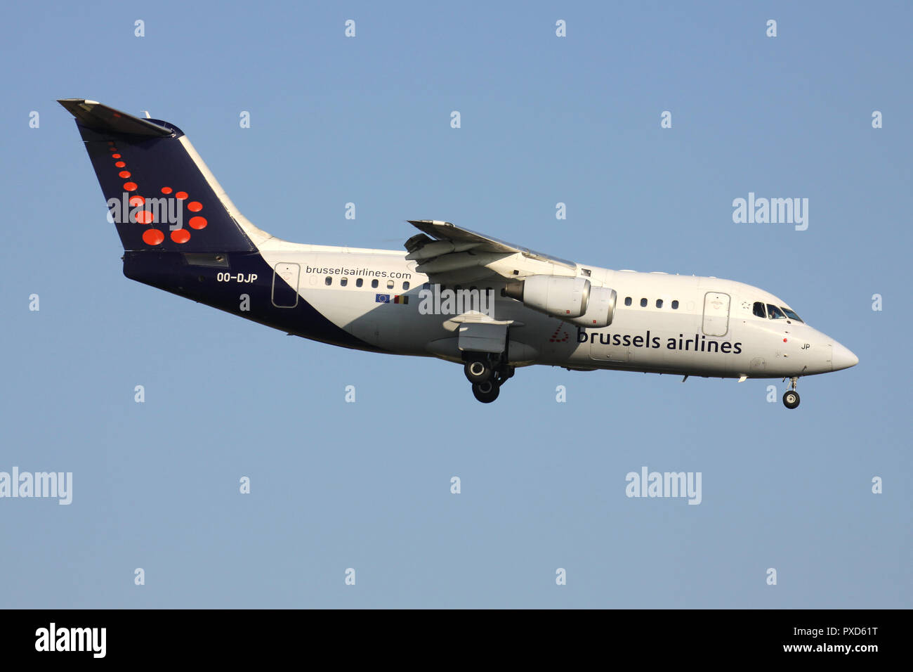 Belgian Brussels Airlines Avro RJ85 with registration OO-DJP on short final for runway 01 of Brussels Airport. - Stock Image