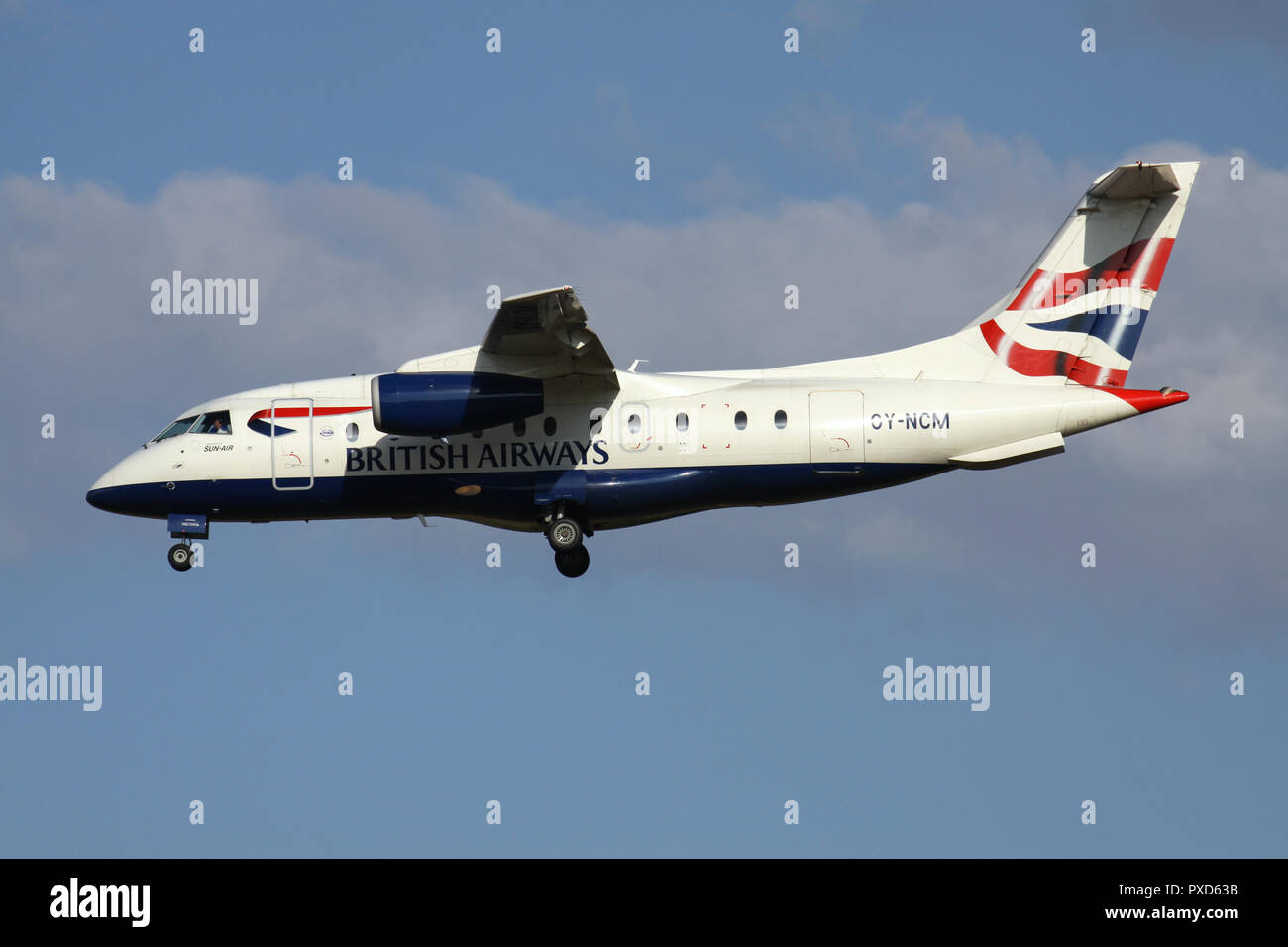 Sun-Air of Scandinavia Dornier 328JET in British Airways livery with registration OY-NCM on short final for runway 01 of Brussels Airport. Stock Photo