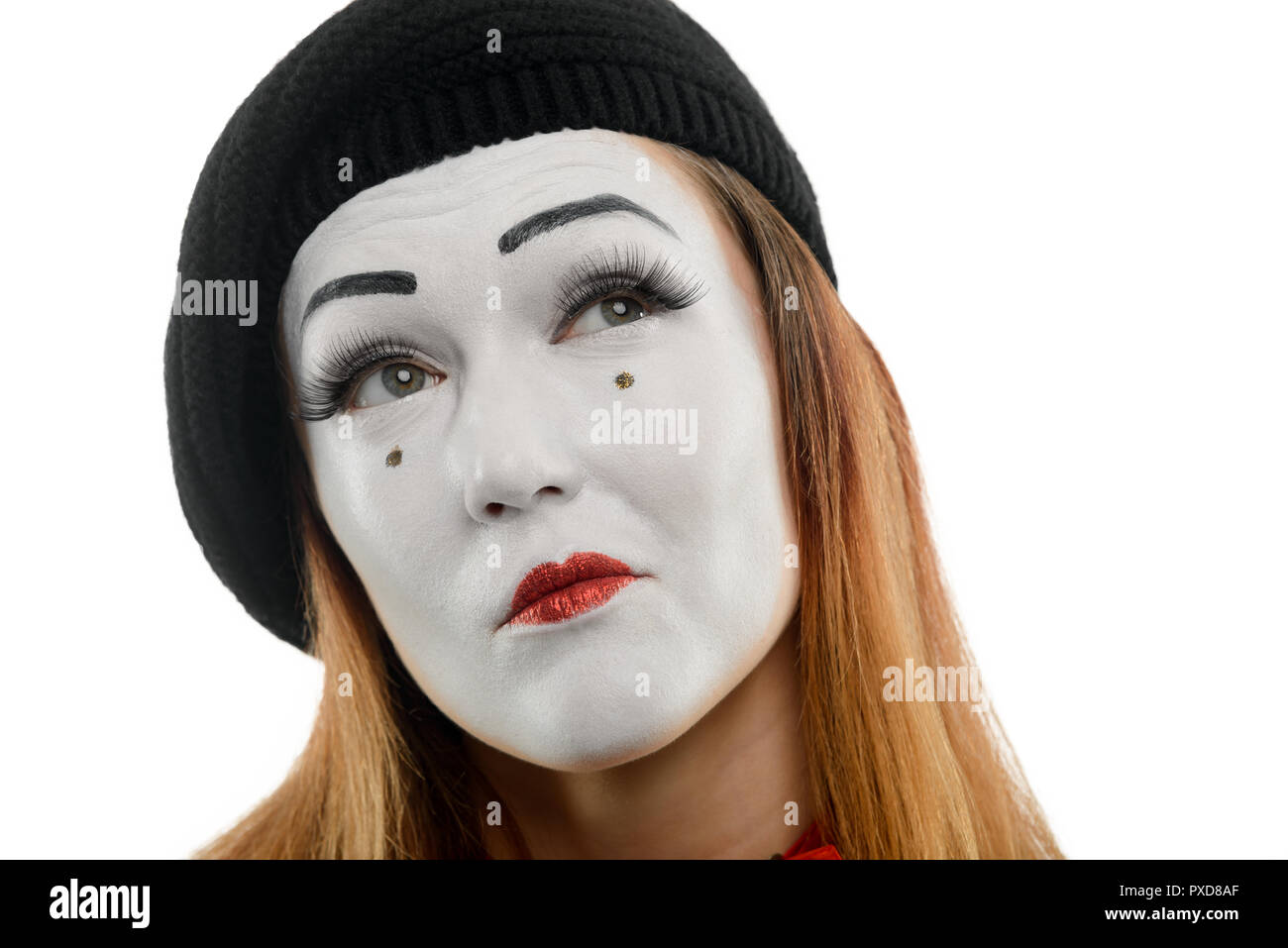 Thoughtful female mime on white - Stock Image