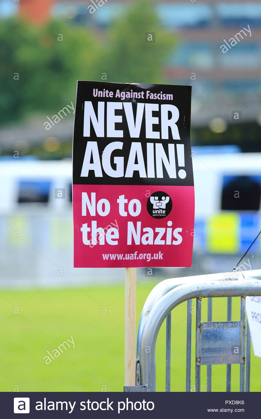 Stand Up To Racism. A Never Again No To Nazi's Placard at Manchester Piccadilly Gardens Manchester UK Afternoon - Stock Image