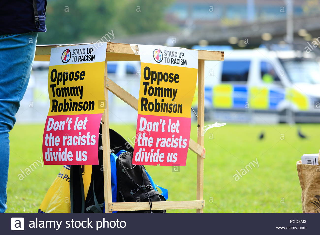 Stand Up To Racism. A Oppose Tommy Robinson Placard at Manchester Piccadilly Gardens Manchester UK Afternoon - Stock Image