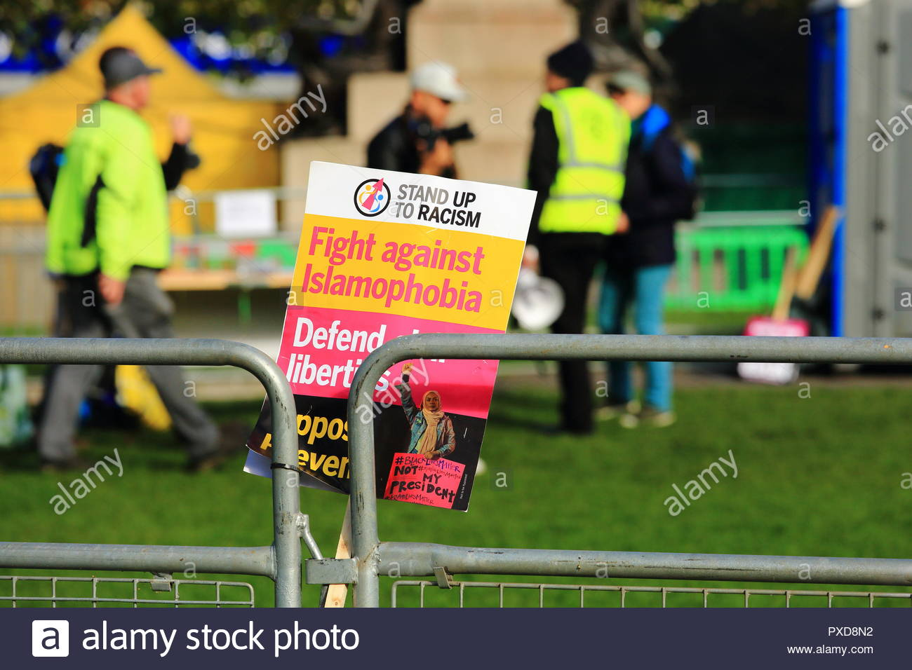 Stand Up To Racism. A Fight Against Islamophobia Placard at Manchester Piccadilly Gardens Manchester UK Afternoon - Stock Image