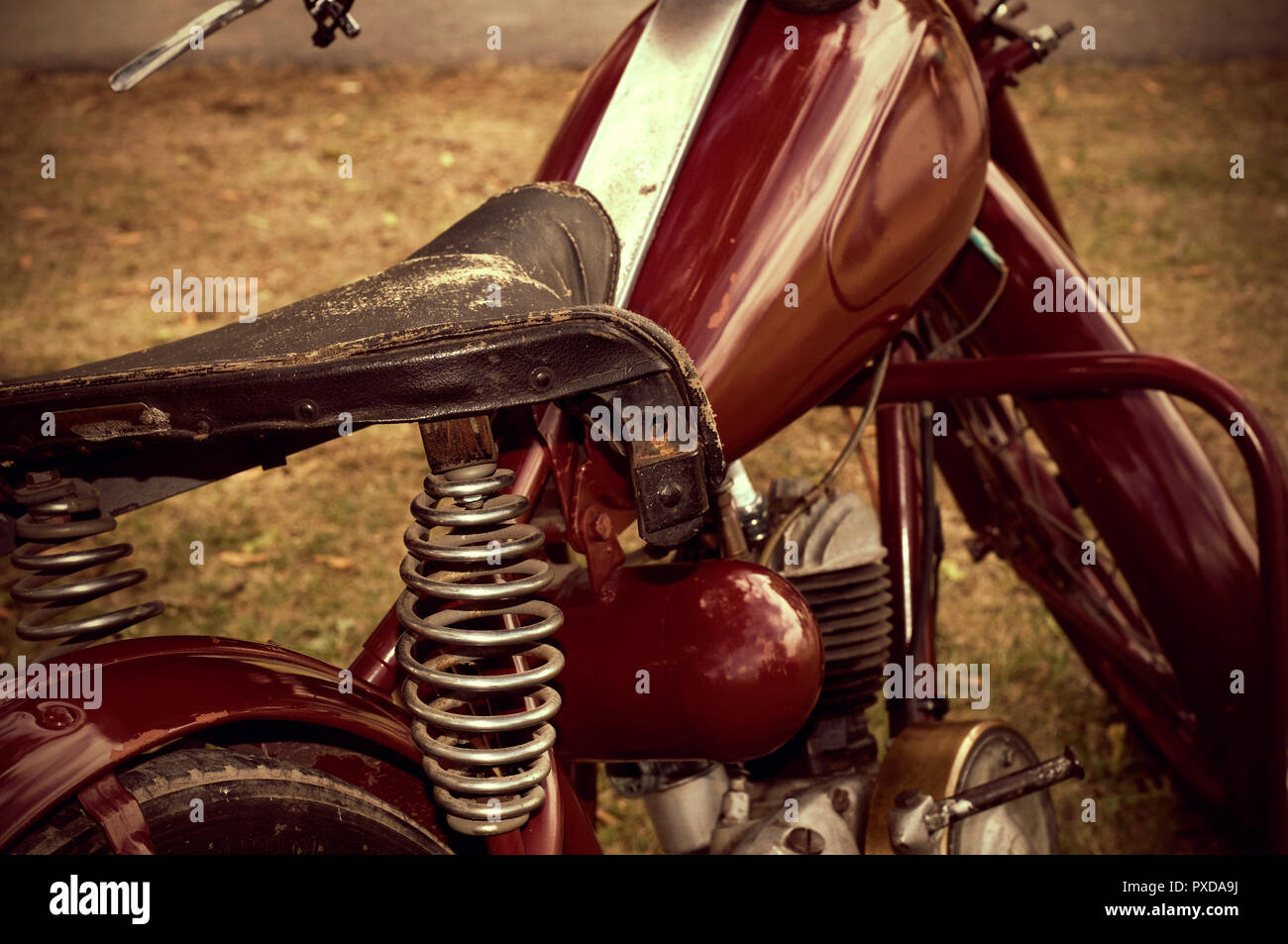 52245ae18a30e Beautiful Classic Antique Motorcycle with Weathered Leather Seat ...