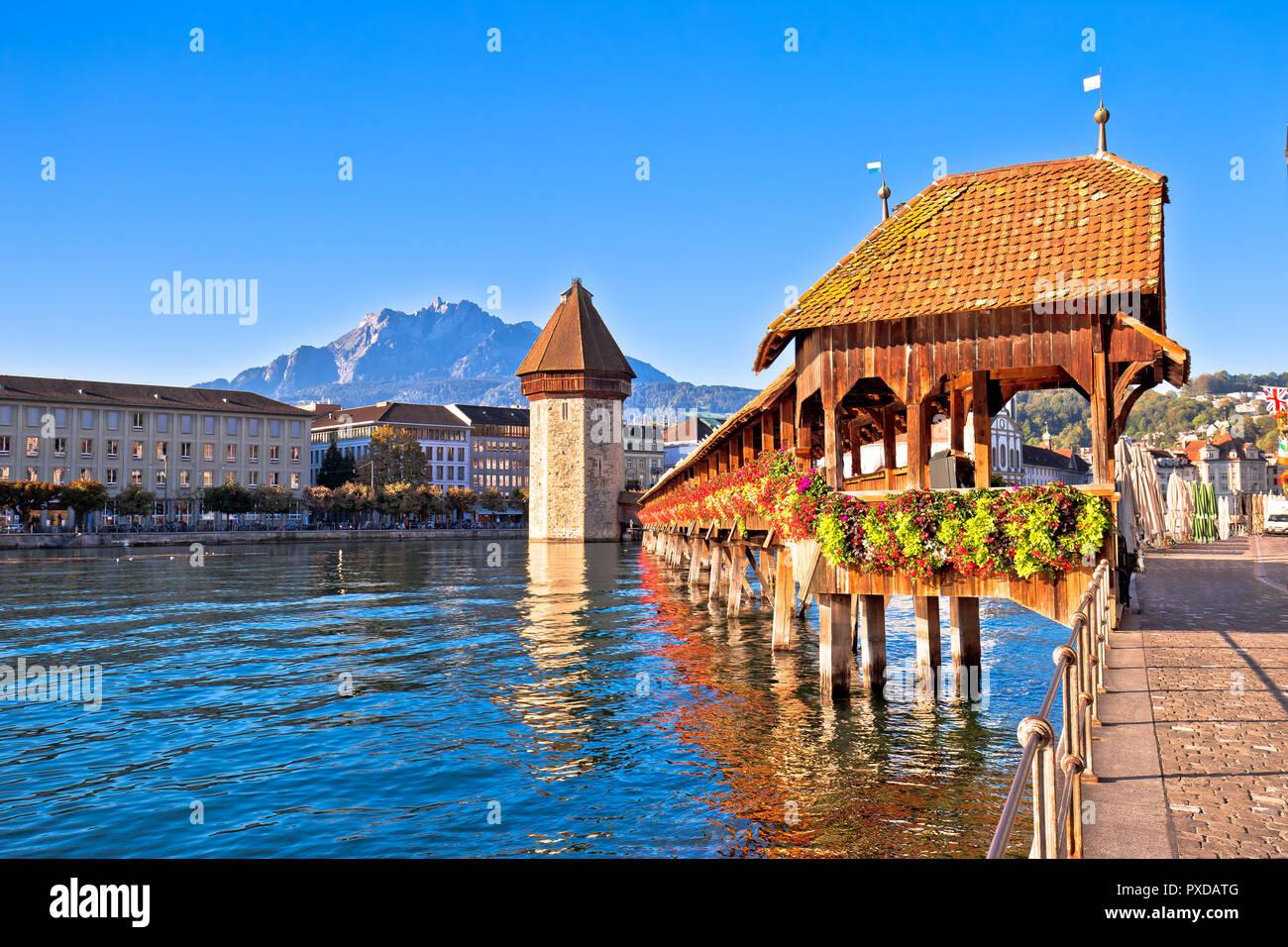 Kapellbrucke historic wooden bridge in Luzern and waterfront landmarks view, town in central Switzerland Stock Photo