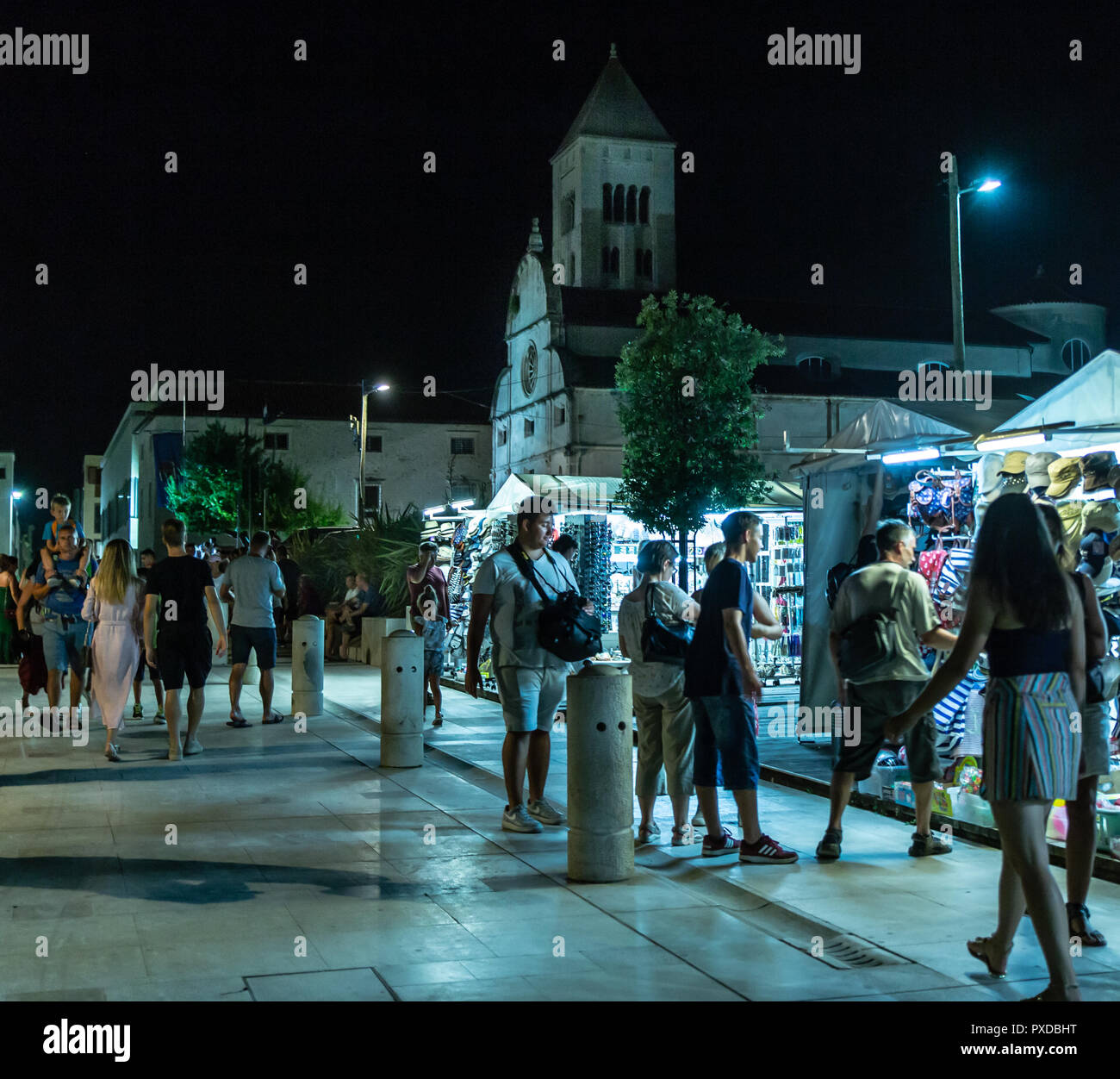 Zadar outdoor market and tourists in front of St Marys Church & benedictine monastry, Croatia 2018 - Stock Image