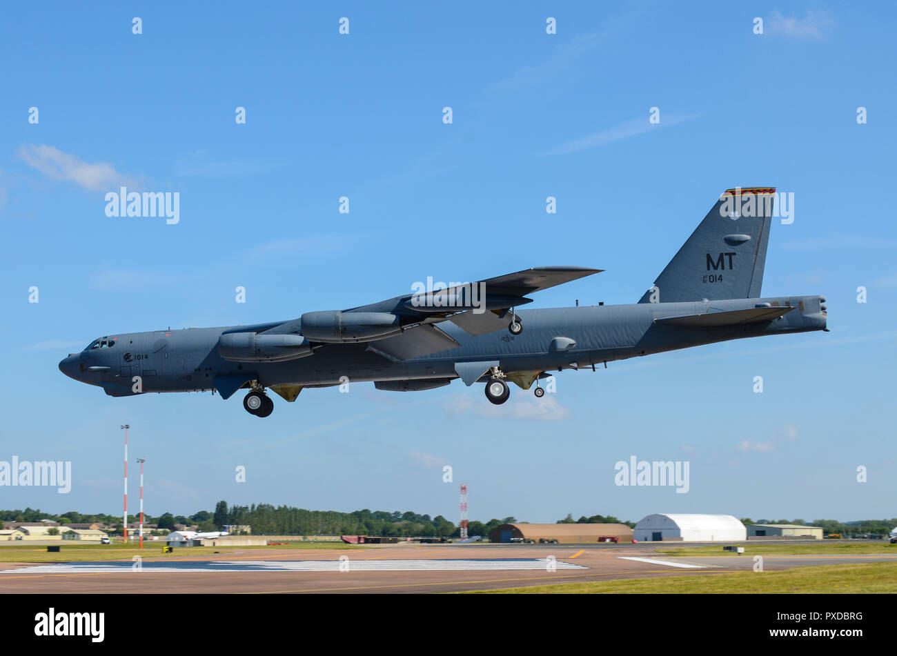 Boeing B-52 Stratofortress nuclear bomber landing at RAF Fairford for RIAT Royal International Air Tattoo. Space for copy Stock Photo