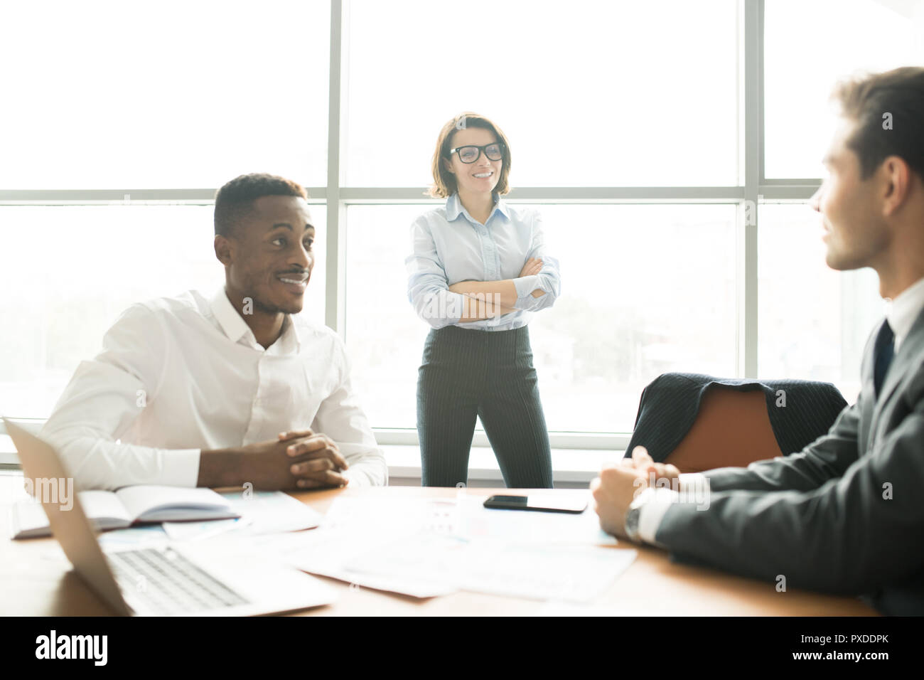 Modern multi-ethnic business experts discussing startup project  - Stock Image