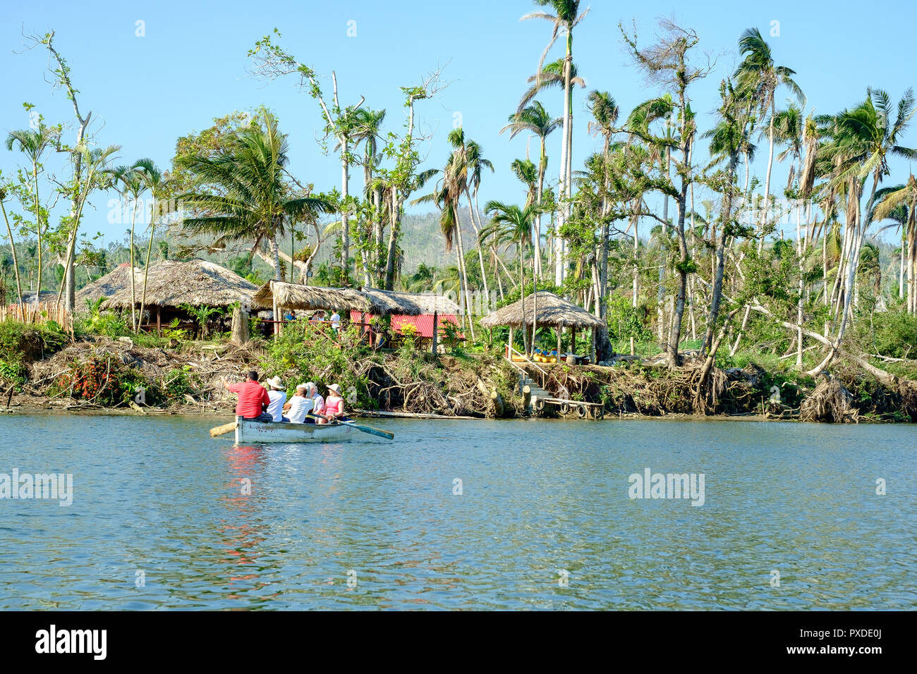 Tourists in a Rowing Boat on the River Toa, Baracoa, Cuba - Stock Image