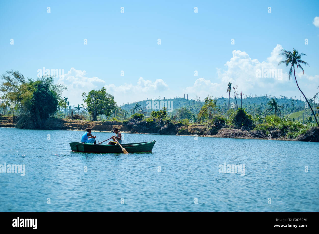Two Cuban Men in a Rowing boat on the River Toa - Stock Image