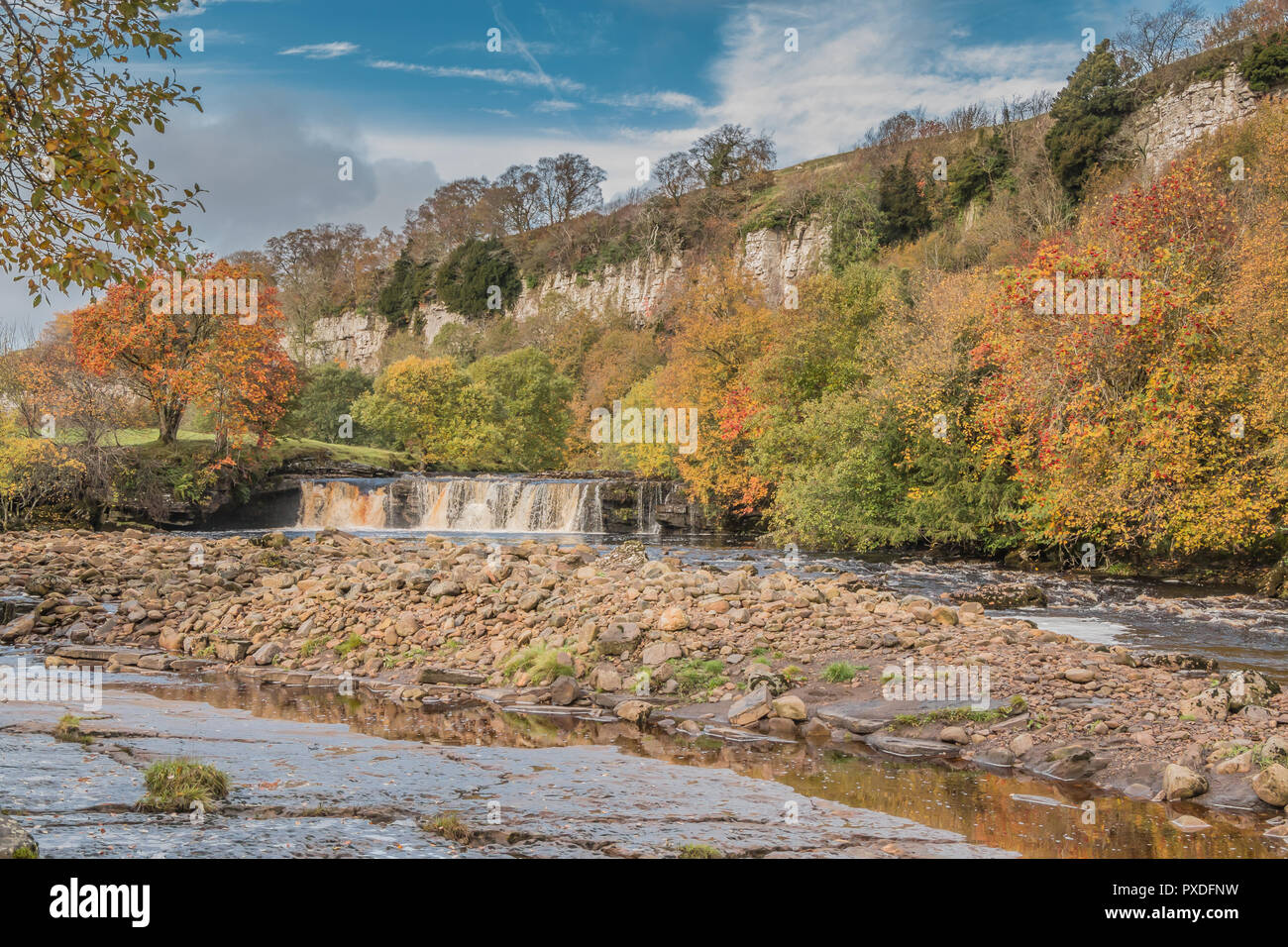 Yorkshire Dales National Park autumn landscape, vivid autumn colours at Wain Wath Falls, Swaledale, UK Stock Photo