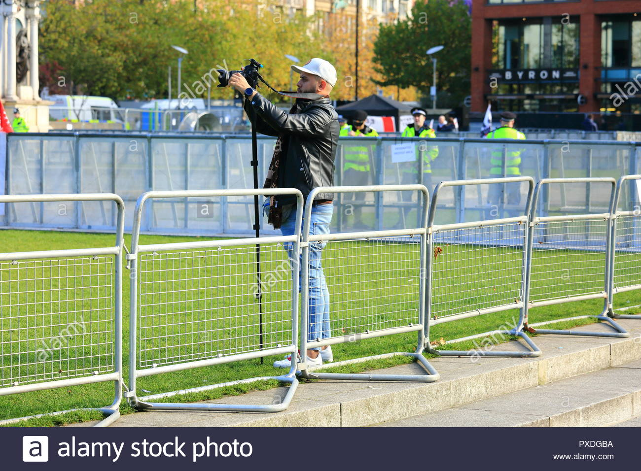 A cameraman filming at Stand Up To Racism Demonstration Piccadilly Gardens Manchester UK Afternoon - Stock Image