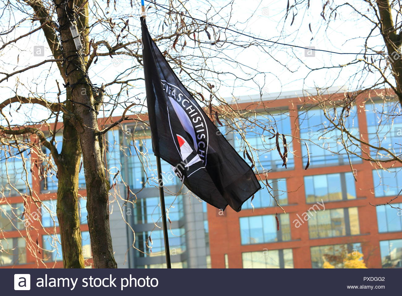 An Anti Fascist Flag Flying High AT The Stand Up To Racism Protest At Manchester Piccadilly Gardens Manchester UK. Afternoon - Stock Image
