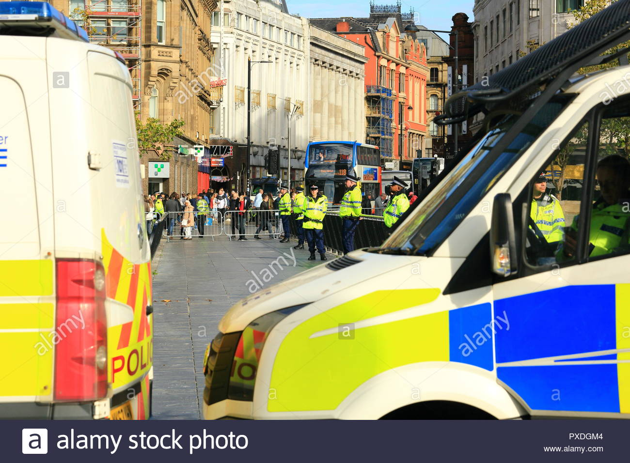 A strong police presence at Stand Up To Racism Demonstration Piccadilly Gardens Manchester UK Afternoon Stock Photo