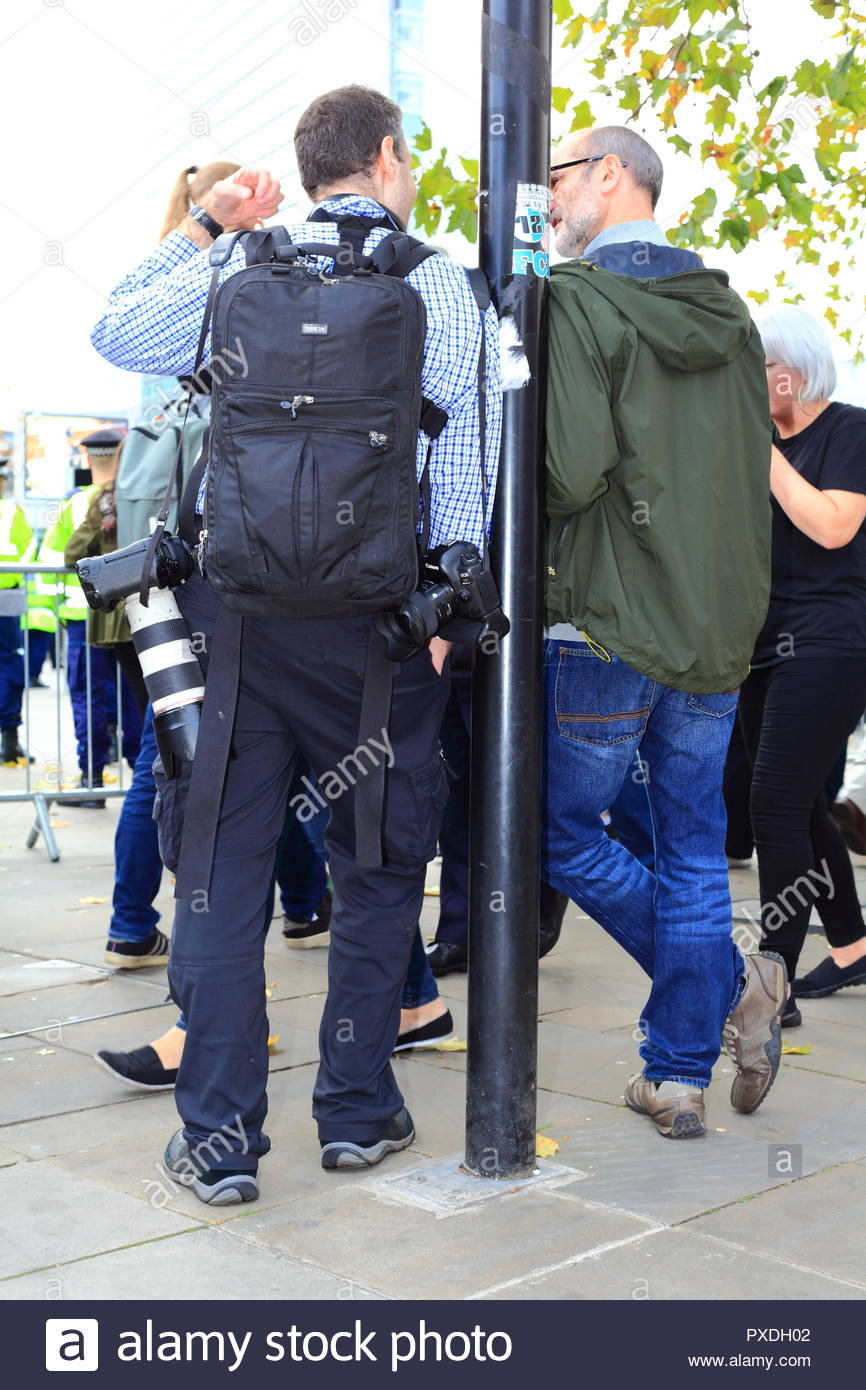 A photographer speaking with a member of the public at Stand Up To Racism Demonstration Piccadilly Gardens Manchester UK Afternoon - Stock Image