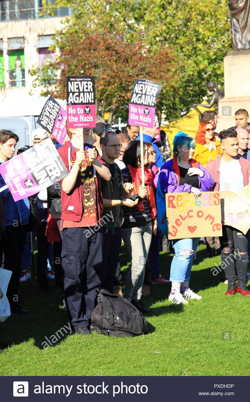 Protesters demonstrating at the Stand Up To Racism Demonstration at Piccadilly Gardens Manchester UK. October 2018 Afternoon - Stock Image