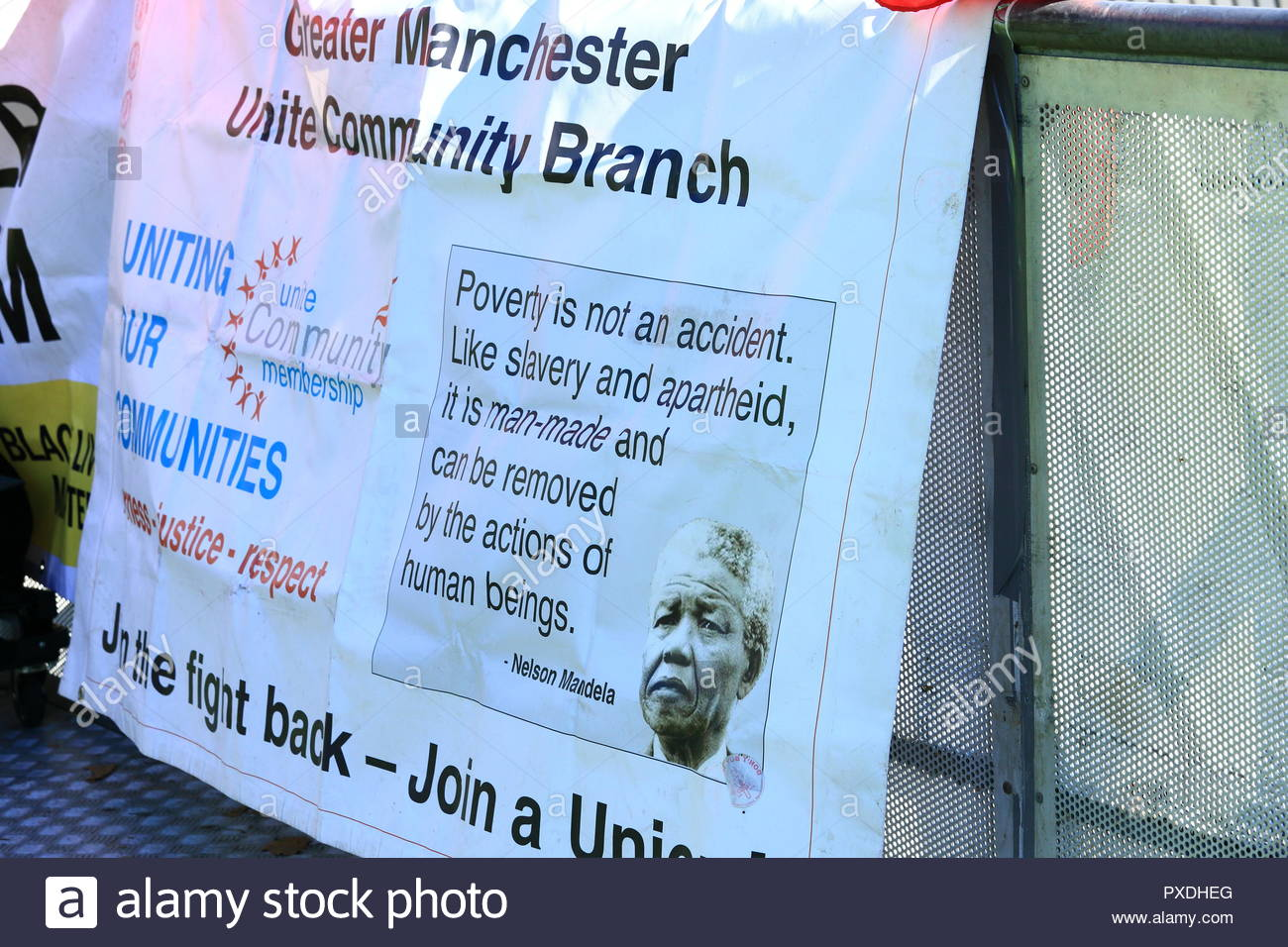 A Nelson Mandela Banner at the Stand Up To Racism Demonstration at Manchester Piccadilly Gardens Manchester UK. Afternoon. - Stock Image