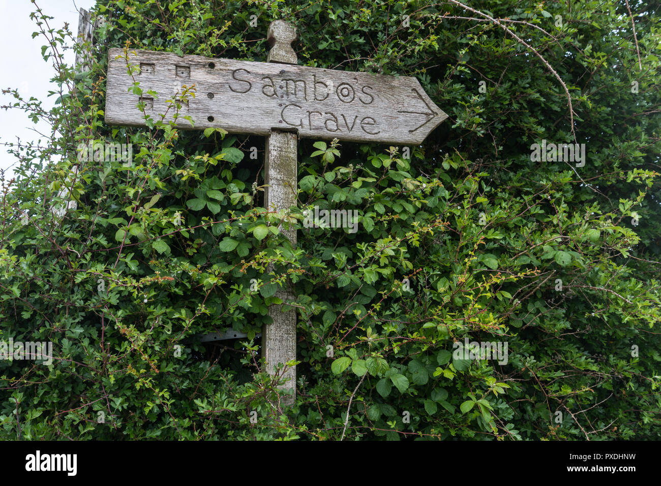 Direction sign to the grave of an 18th Century West Indian negro slave called Sambo at the remote Lancashire village of Sunderland Point, England, UK - Stock Image