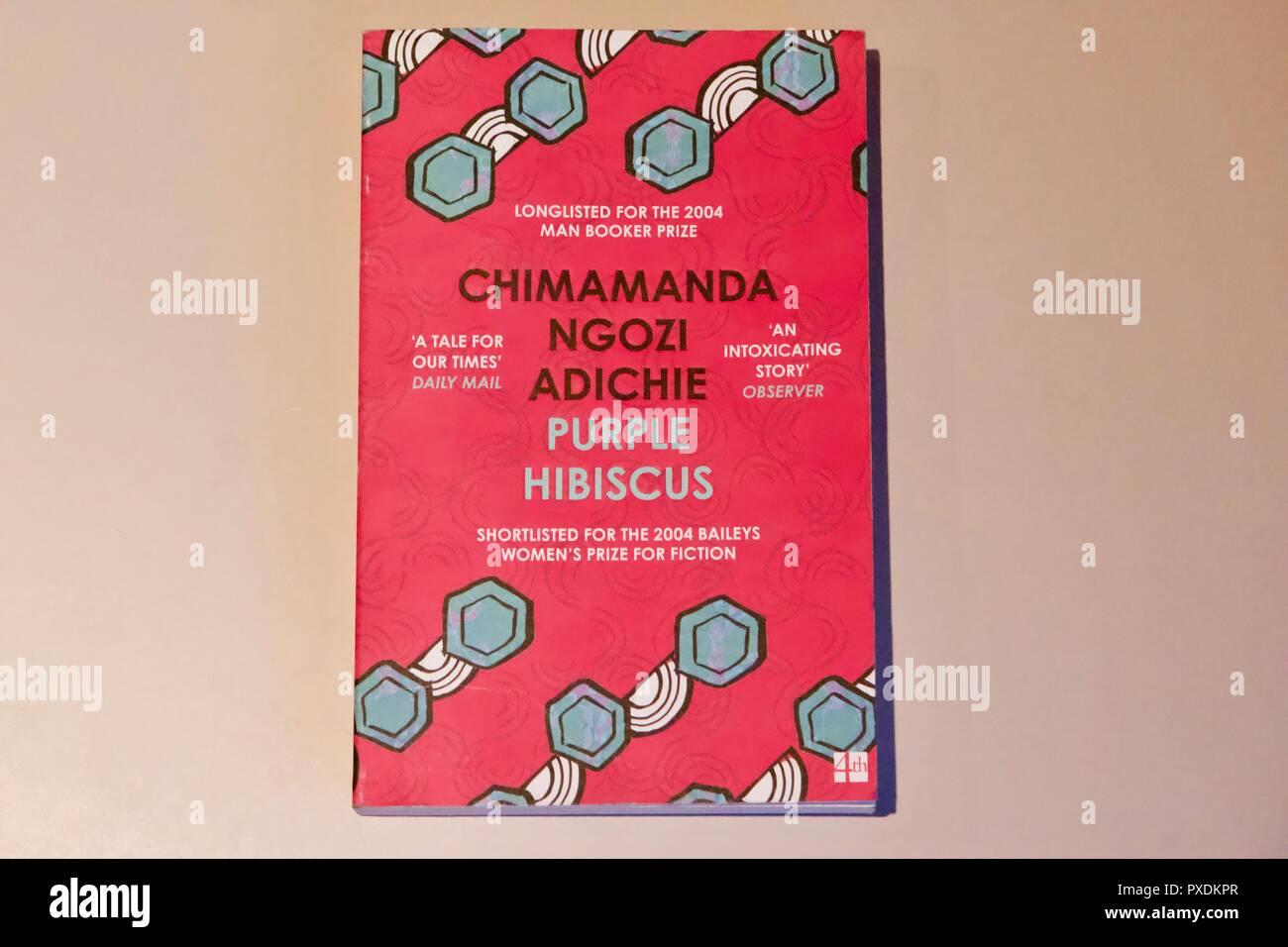 A Pink Paperback Novel Called Purple Hibiscus By Chimamanda Ngozi