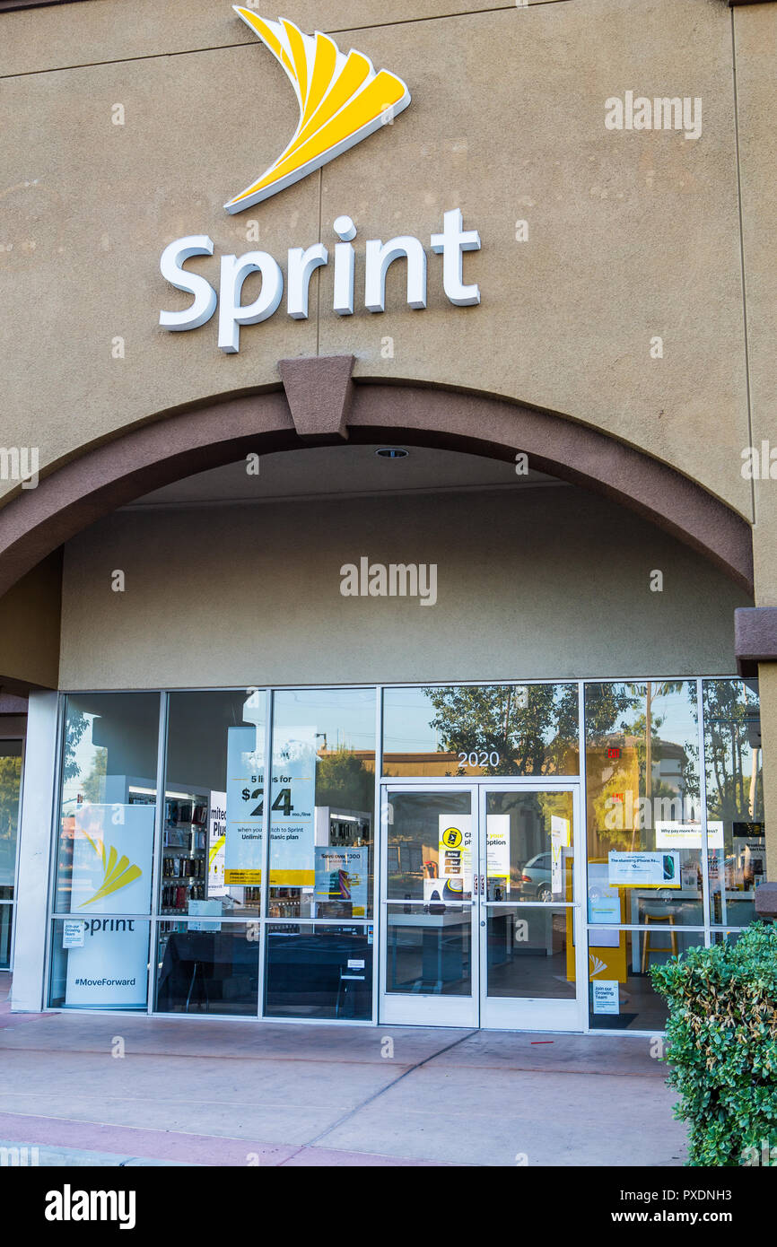 American telecommunications company Sprint store building exterior sign and logo - Stock Image