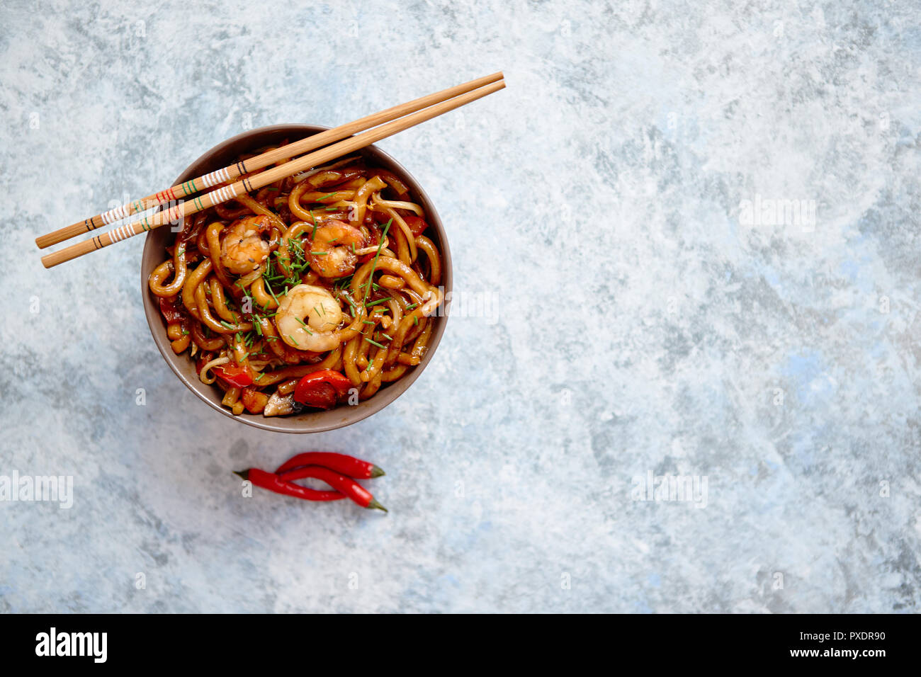 Traditional asian udon stir-fry noodles with shrimp Stock Photo