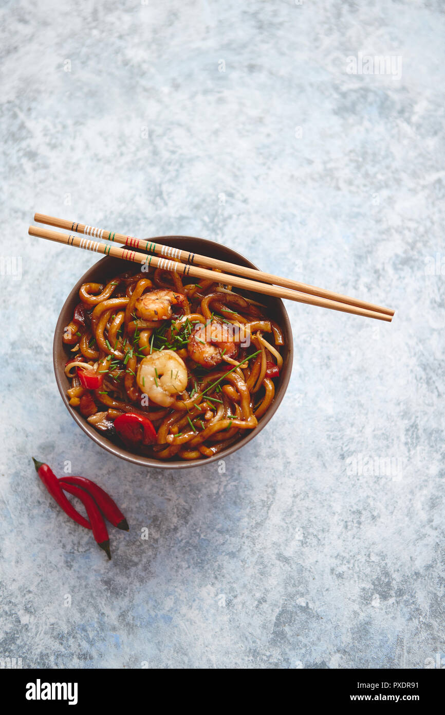 Traditional asian udon stir-fry noodles with shrimp - Stock Image