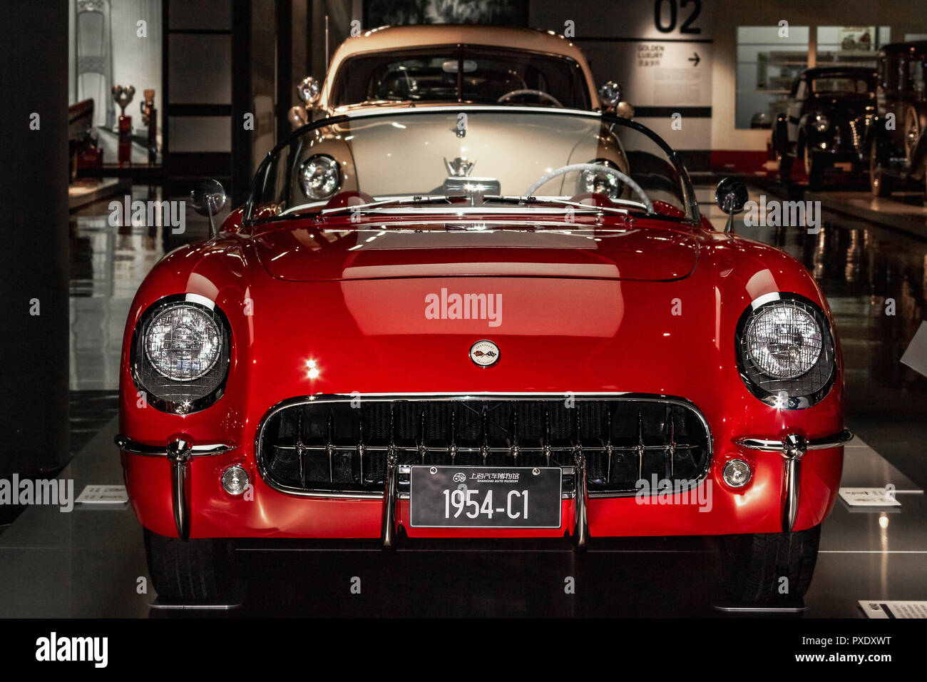 Shanghai Auto Museum exhibits a collection of vintage and modern automobiles, details and the device and development automotive industry. Exebition in Shanghai city of China. - Stock Image