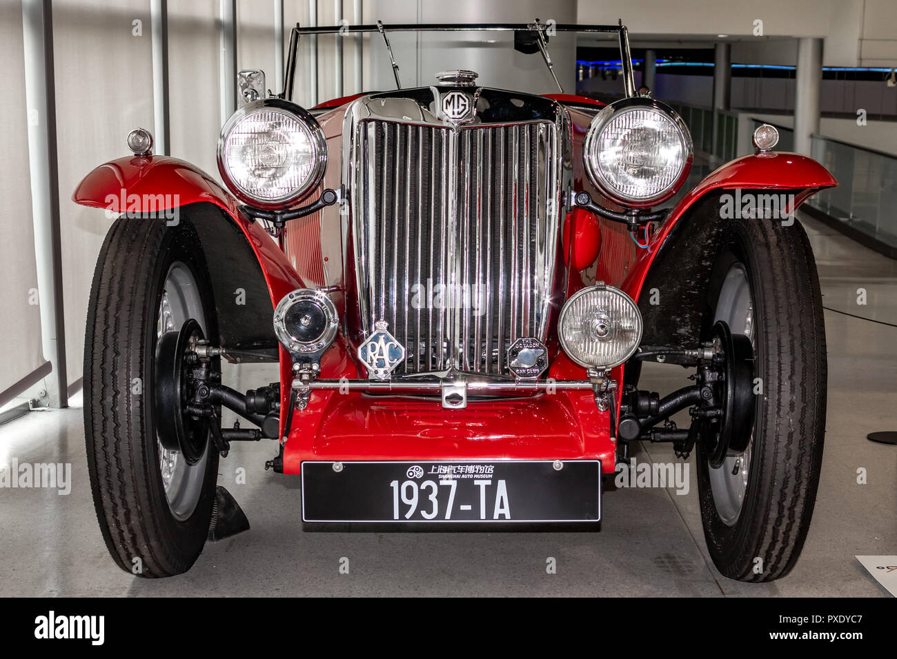 Shanghai Auto Museum exhibits a collection of vintage and modern automobiles, details and the device and development automotive industry. Exebition in Shanghai city of China. Stock Photo