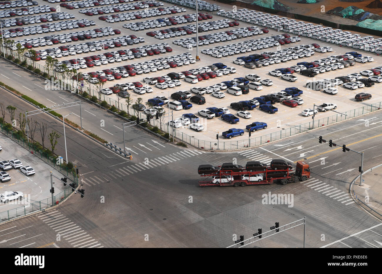 (181022) -- BEIJING, Oct. 22, 2018 (Xinhua) -- A truck loaded with new cars drives in Guoyuan Port in Chongqing, southwest China, Aug. 20, 2018. China's road freight transport continued fast expansion in the first nine months of 2018, the Ministry of Transport said in a statement Oct. 20, 2018. From January to September, the amount of cargo carried on roads, which takes up the lion's share in China's total cargo transport, increased 7.5 percent year on year to 28.64 billion tonnes. The growth came amid China's steady economic growth, which stood at 6.7 percent in the three quarters, above the Stock Photo