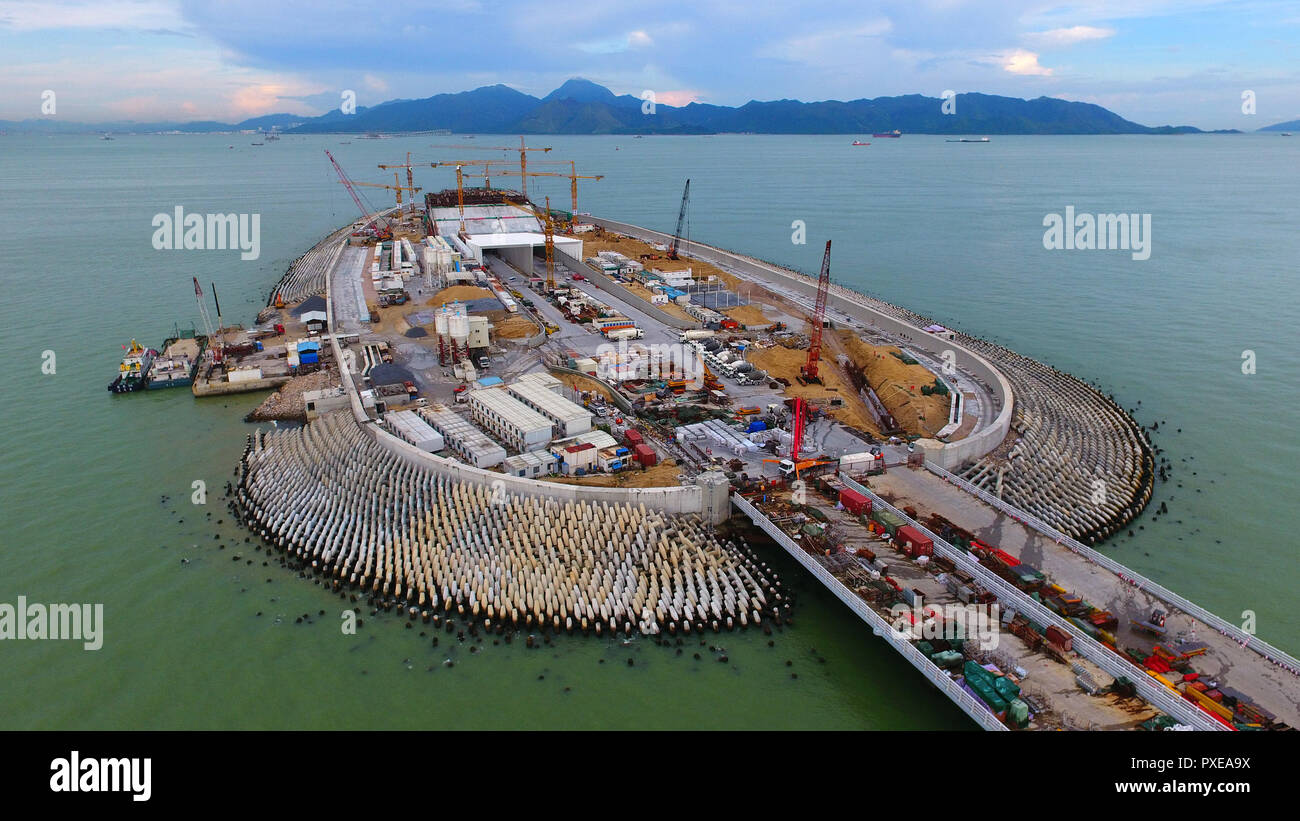 (181022) -- ZHUHAI, Oct. 22, 2018 (Xinhua) -- Aerial photo taken on July 4, 2017 shows the construction site of the Hong Kong-Zhuhai-Macao Bridge in the Lingdingyang waters, south China. The Hong Kong-Zhuhai-Macao Bridge is to be officially open to traffic at 9 a.m. on Oct. 24.  The 55-kilometer-long bridge, situated in the Lingdingyang waters of the Pearl River Estuary, will be the world's longest sea bridge. The construction began on Dec. 15, 2009.     It will slash the travel time between Hong Kong and Zhuhai from three hours to just 30 minutes, further integrating the cities in the Pearl R - Stock Image