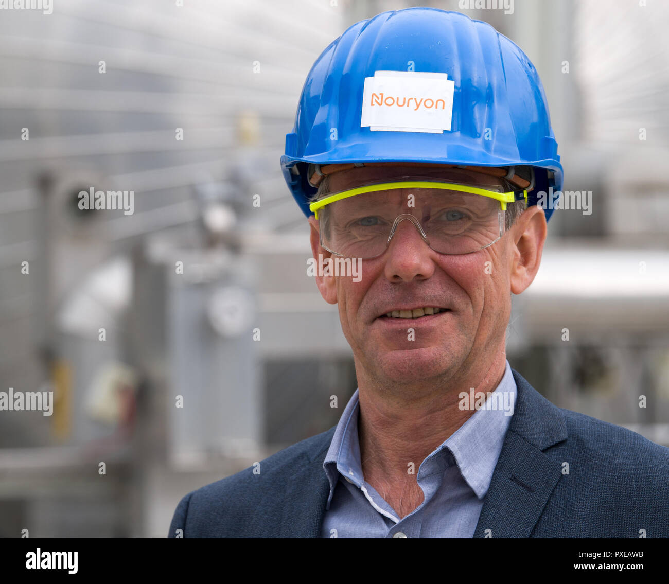Bitterfeld Wolfen, Germany. 22nd Oct, 2018. Stefan Kauerauf, plant manager of the chemical company Nouryon, stands in front of a plant in the chemical park. The former AkzoNobel Specialty Chemicals now operates as an independent company under the name Nouryon. The division was taken over by the US Carlyle Group. In Bitterfeld, the company operates a chlor-alkali electrolysis plant. Credit: Hendrik Schmidt/dpa-Zentralbild/dpa - ACHTUNG: Nur zur redaktionellen Verwendung im Zusammenhang mit der Berichterstattung über Nouryon/dpa/Alamy Live News Stock Photo