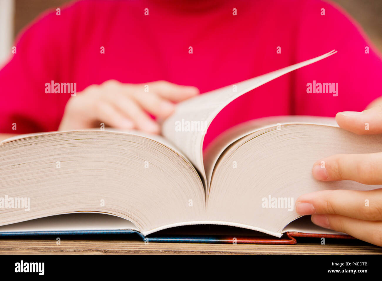 Turn The Page High Resolution Stock Photography and Images - Alamy