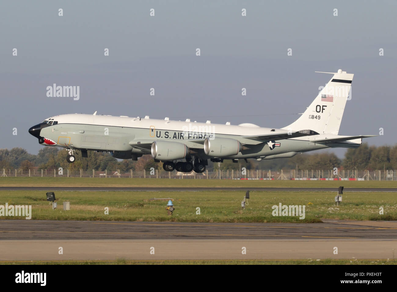 USAF RC-135U 'Combat Sent', one of only two in the USAF inventory on the approach into RAF Mildenhall after a surveillance mission. - Stock Image