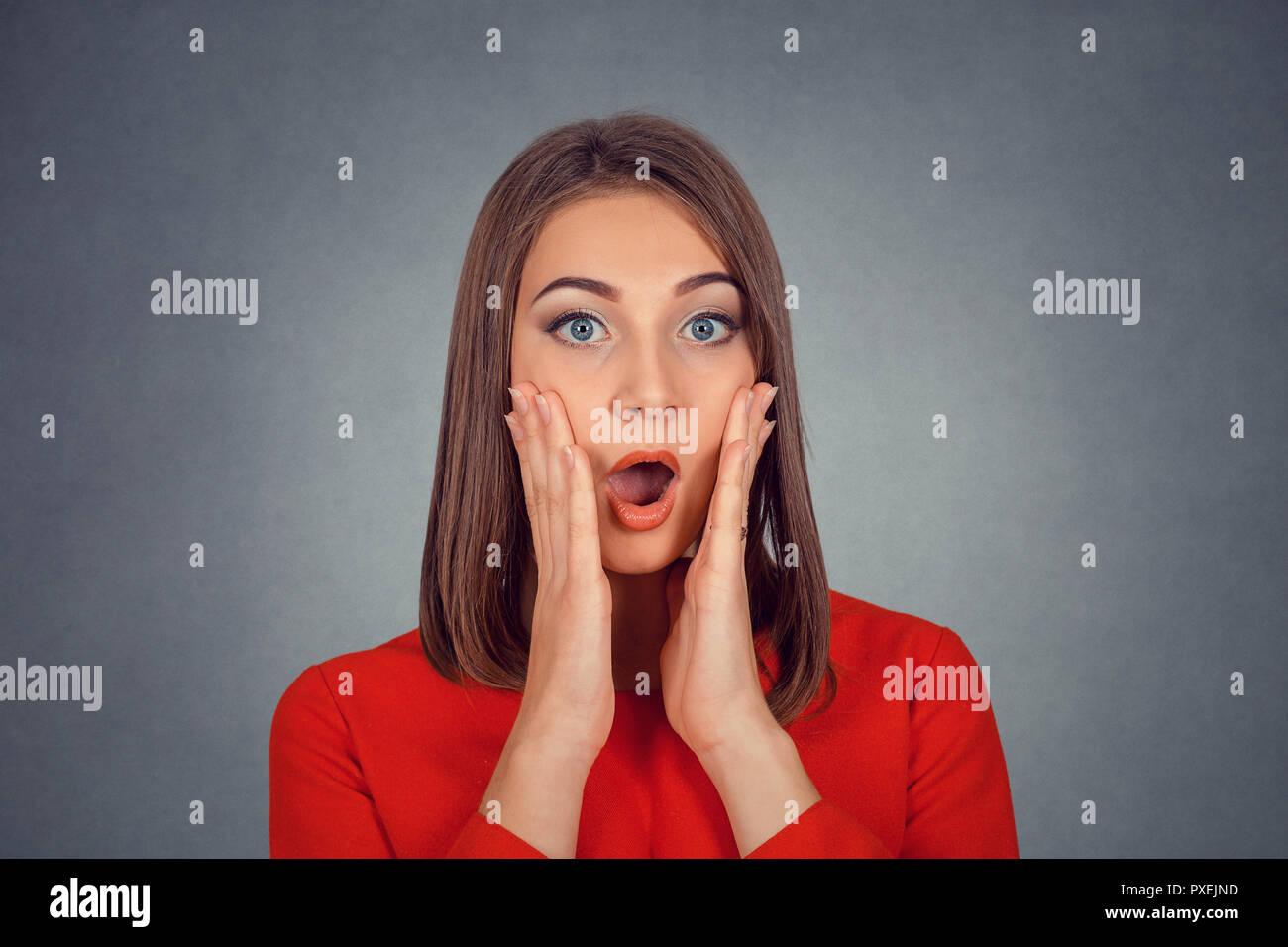 Shocked surprised stunned woman - Stock Image