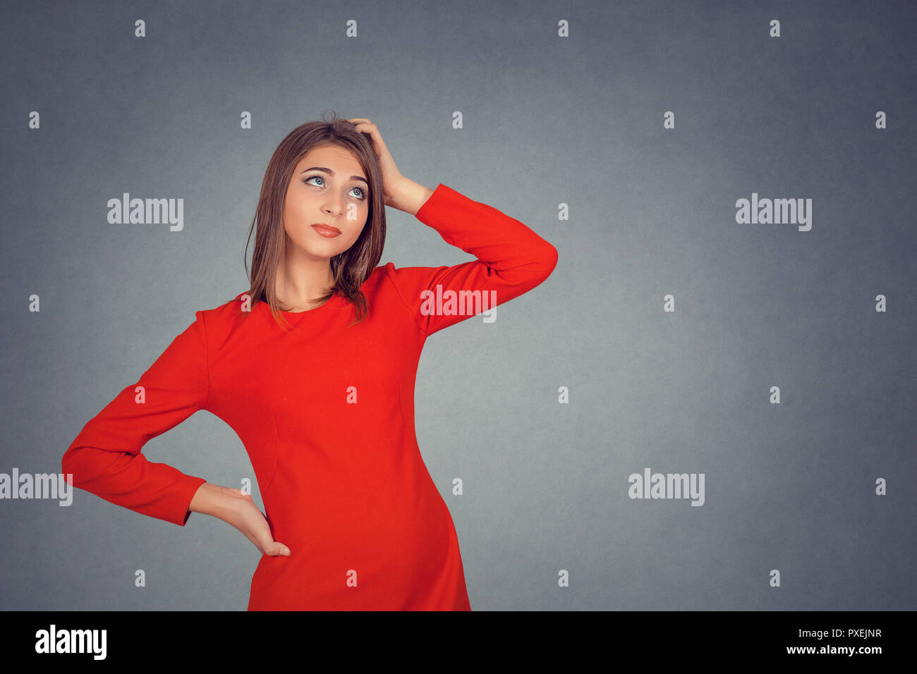 woman scratching head, thinking - Stock Image