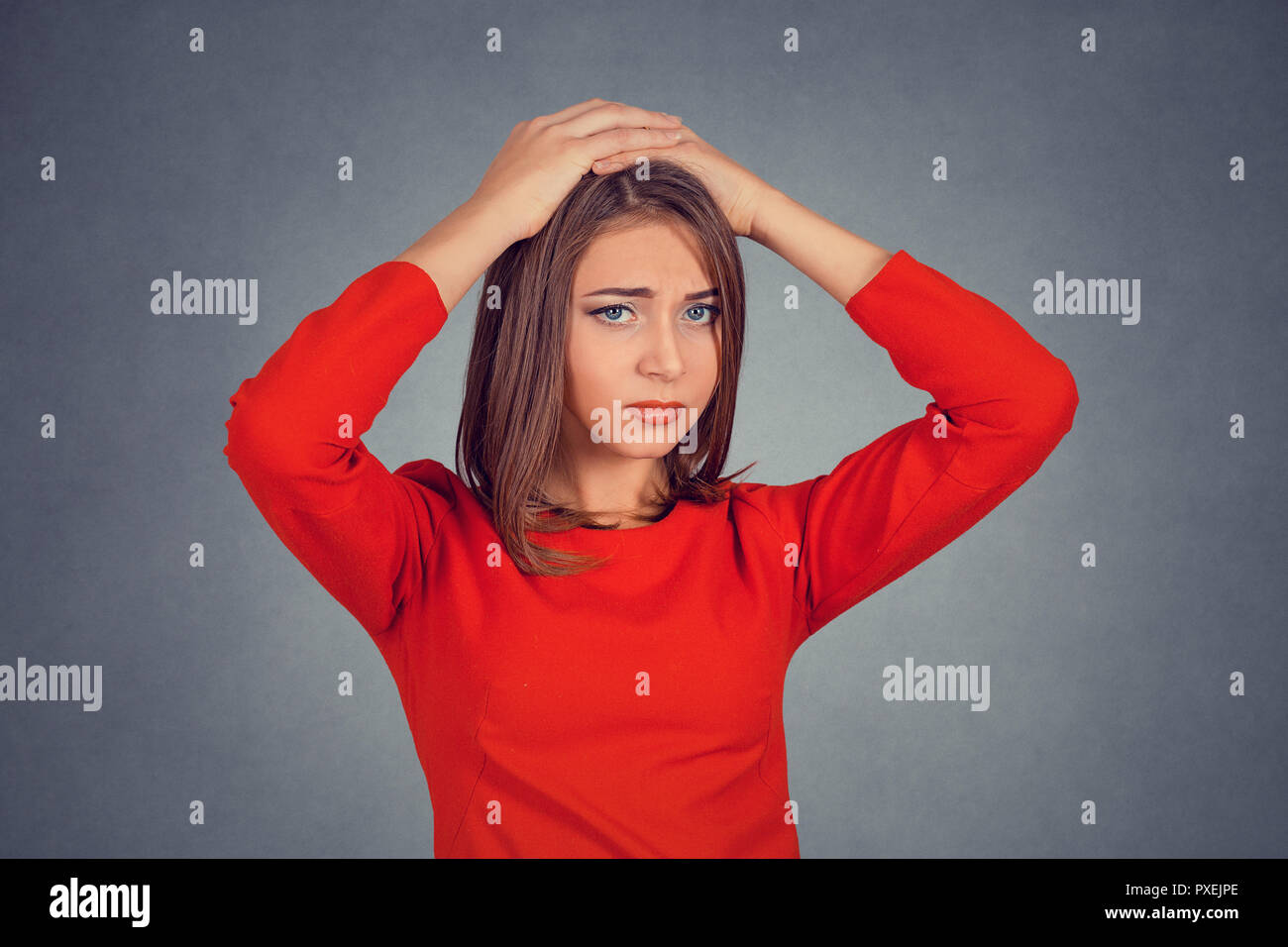 stressed out young woman with worried face expression looking - Stock Image