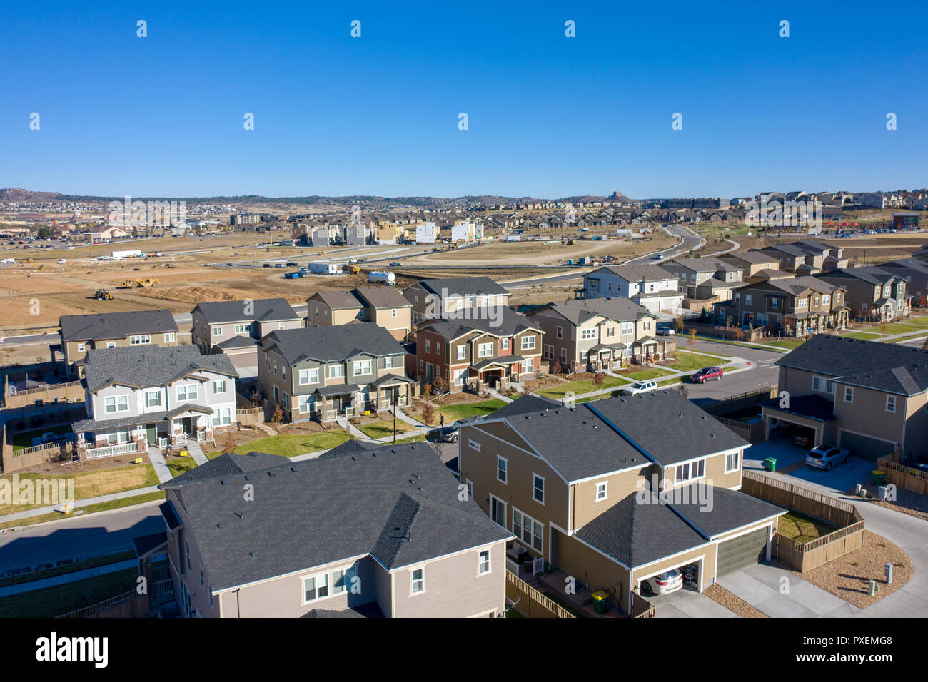 Urban sprawl homes with new construction in the background - Stock Image