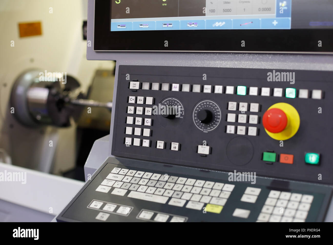 CNC lathe machine with a control panel. Selective focus. - Stock Image